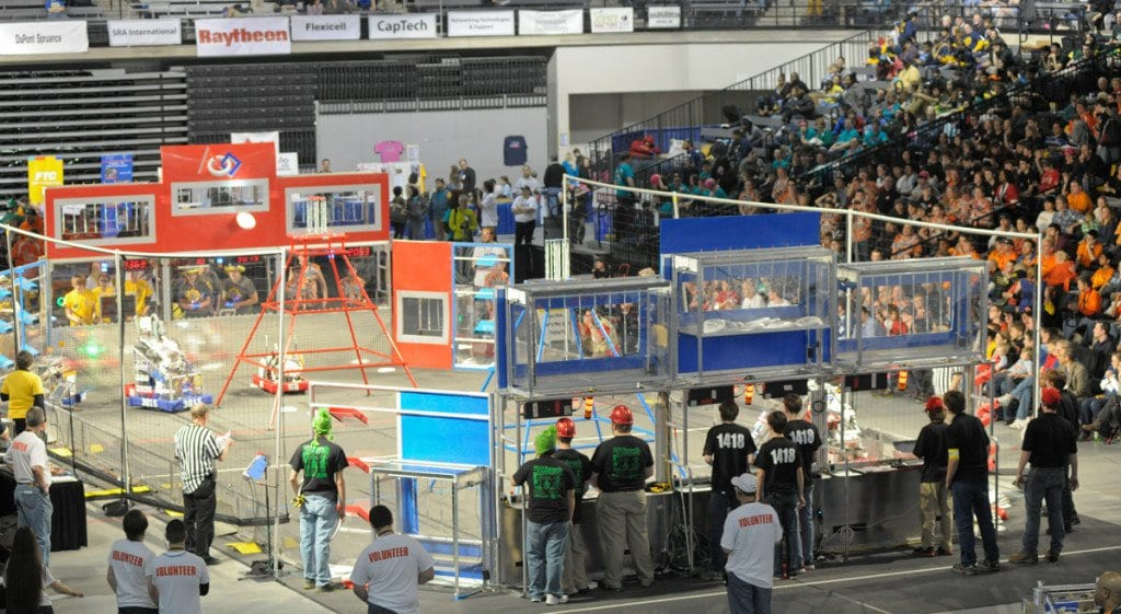 Team 1418 from George Mason High School guides its robot through an event at the FIRST Robotics Virginia Regional Tournament last weekend. The team made it into the semifinals of the competition.   (Photo: Arthur W. Pierson)