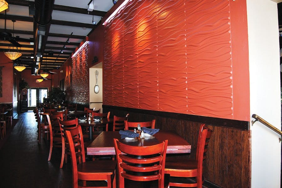 RENOVATIONS TO ARGIA'S included large red acoustic tiles to help reduce noise in the dining room. (Photo: News-Press)