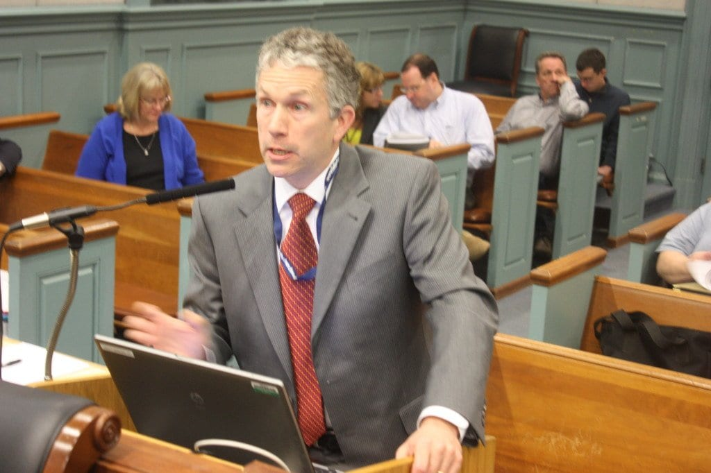 Falls Church City Manager Wyatt Shields presents his recommended Fiscal Year 2014 budget to the F.C. City Council tonight, as behind him over his right should School Board Chair Susan Kearney listens. (Photo: News-Press)
