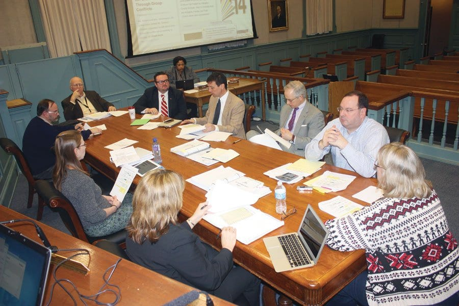THE FALLS CHURCH SCHOOL BOARD engaged in intense deliberations Tuesday night prior to voting on its budget for the coming fiscal year that will now go to the City Council, where the budget needs to be approved for the requested enrollment-driven funding level or reduced to something less. (News-Press Photo)