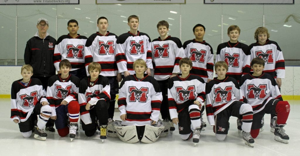 Mary Ellen Henderson Middle School hockey players (pictured above from left to right, wearing George Mason High School jerseys, front row) are Jackson Oppel, Henry Middlebrook, Ethan Rosenberger, Jack MacKinnon, Jack Meteyer, Jacob Lechner, Tom Ferrick, (back row) Coach Stan Fendley, Jacob Jafari, Brendan Bernstein, Cole McDowell, Alec Reusch, Alex Wang, Andrew Fischer, and Michael Sevachko. Patrick Brown, Ryan Henderson, and Alex Kryazhev are not pictured. (Photo: Paul McDowell)