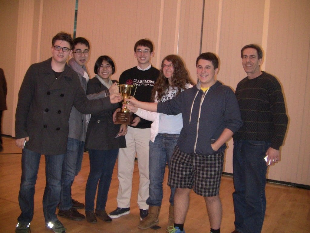 George Mason High School's scholastic bowl team (with coach Jamie Scharff, far right) is pictured above with its state tournament trophy. George Mason has won the state championship the past four years. (Photo: Courtesy Susan Earman)