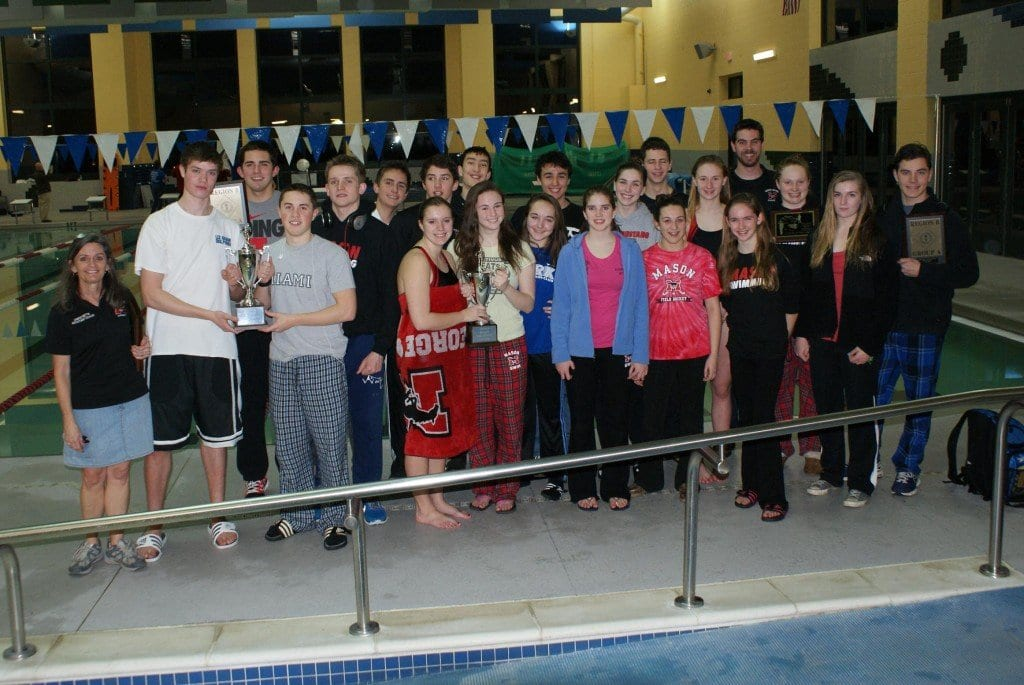 George Mason High School swimmers had plenty of hardware to show off after the regional meet last Saturday, as both the boys and girls teams repeated as Region B champions and several of their swimmers took part in setting 11 records that night. (Photo: Carol Sly)