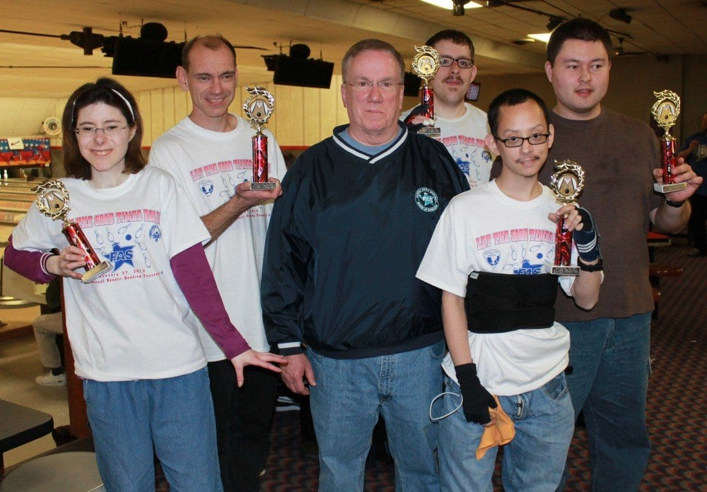 Five Special Olympians receive Outstanding Performance awards from Fairfax Adult Softball President John Carney. FAS held its annual bowling tournament last Sunday and raised almost $14,000 to benefit Northern Virginia Special Olympics and Fairfax County Park Authority field improvements. (Courtesy Photo)