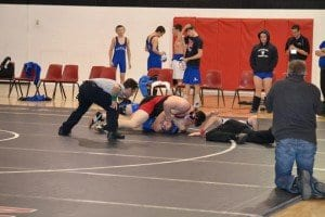 Junior Jake Acosta closed out the George Mason High School wrestling team's tri-meet loss last week on an exciting note by taking down his opponent and pinning him in less than a minute and a half.  (Courtesy Photo)