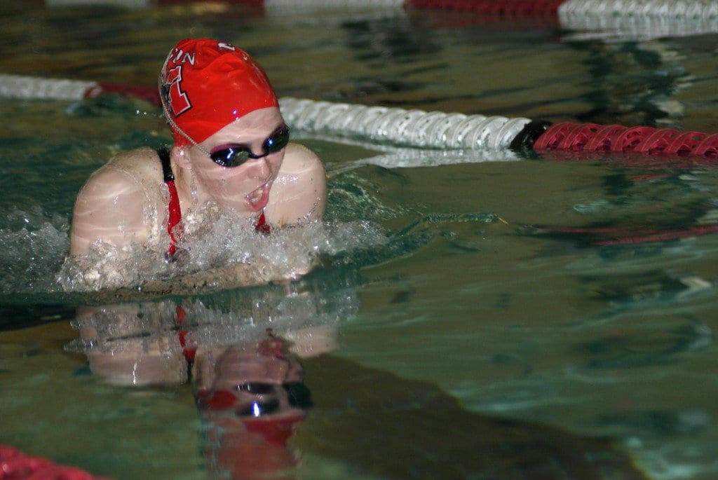 Sophomore Beth Cashin swims the 100-yard breaststroke to a winning time of 1:11.99. (Photo: Carol Sly)