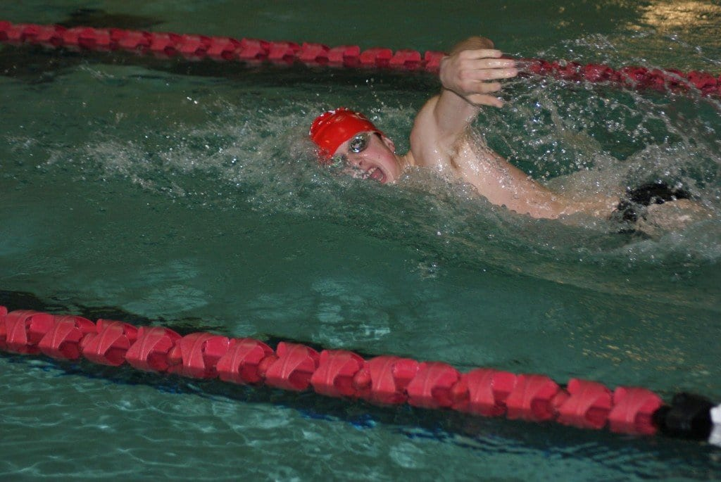 Freshman Miller Surette qualifies for state-level competition for George Mason High School in the 100-yard freestyle event, finishing with a time of 0:51.11. (Photo: Carol Sly)