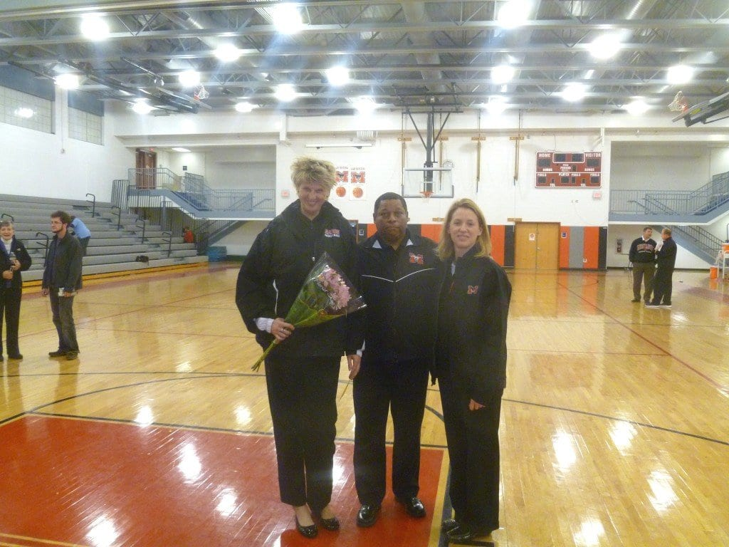The Mason girls basketball coaching team was honored last Friday after the team earned its 100th victory under their guidance. Head Coach LaBryan Thomas is pictured above, with assistant coaches Svetlana Pankratova (left) and Lori Lafave. (Photo: Courtesy Jack Gosnell)