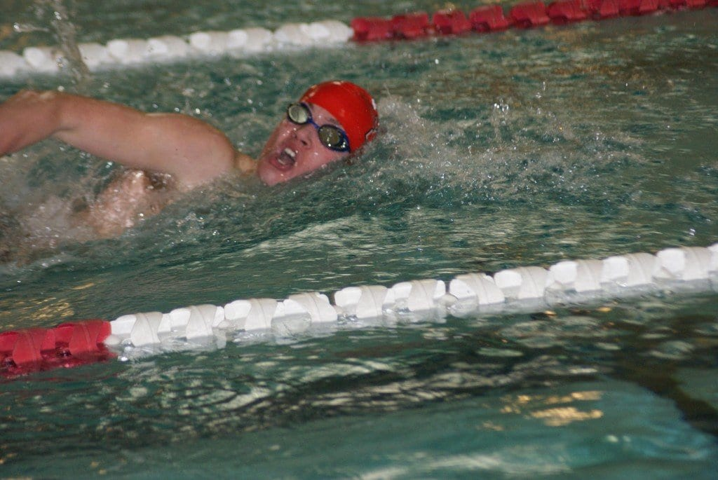 Sophomore swimmer Jared Britton races toward a state qualifying time of 50:45 in the 100-yard freestyle. (Photo: Carol Sly)