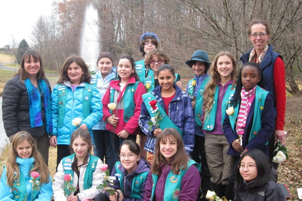 Members of Falls Church-based Junior Girl Scout Troop 6730, who recently won The Bronze Award for their volunteer efforts in growing and harvesting food for Share of McLean, are pictured above. They are (front row) Morgan Feist, Lila Pournaras, Sophia Belvedere, Madeleine LeBeau, Kirsten La Force Regli, (back row) Scout Leader Josephine Aiello LeBeau, Nina Pournaras, Audrey Morse, Sara Mink, Maya Van Dyke, Anna Stein, Sarah Luthra, Lucy Ferlauto, Elena Bachman and Tryphena Koomson. Zoe Abel is not pictured. They are joined by Julie Mendoza (at far right) of The Gardeners' Share, who presented the award to the Scouts.  (Photo: Courtesy Josephine Aiello LeBeau)